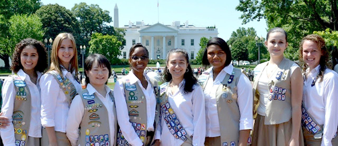 A group of Girl Scouts standing in front of the White House, in Washington, DC
