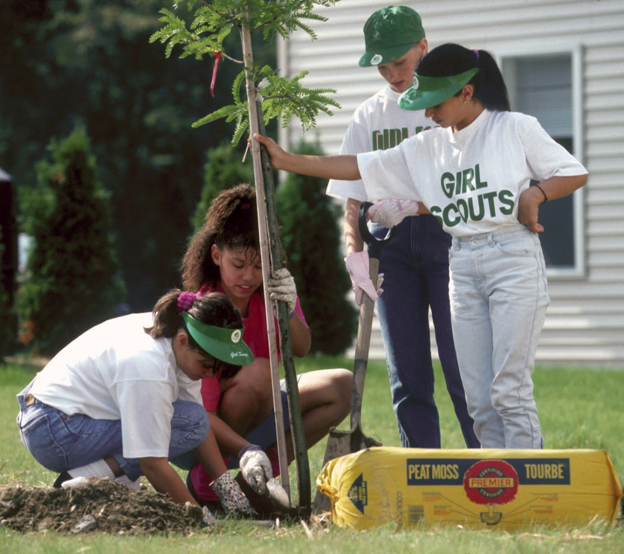 Girl Scouts plant a tree, circa 1990s