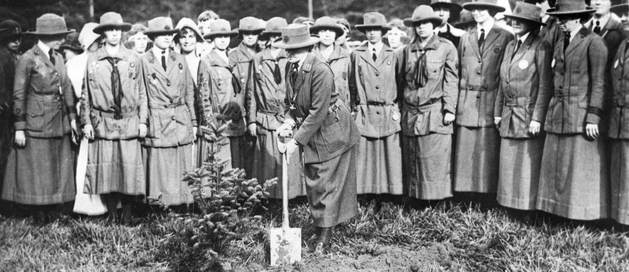 Juliette Gordon Low plants a memorial evergreen sapling at the 3rd International World Conference, 1924