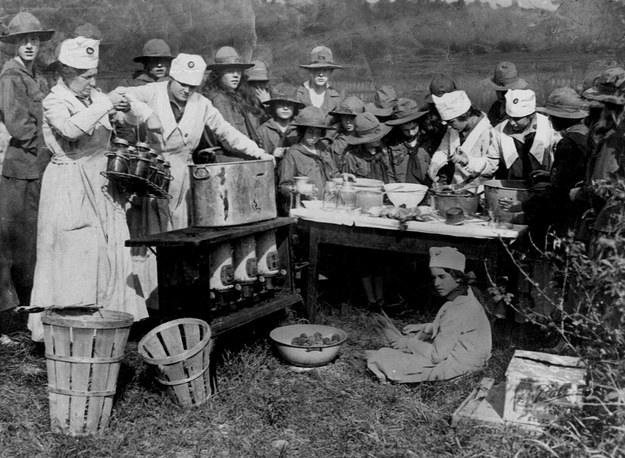 Girl Scouts preserve fruits and vegetables in response to food shortages, circa 1917