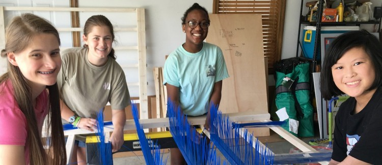 Girl Scouts work together to construct Zipper sensory tool for kids with autism.