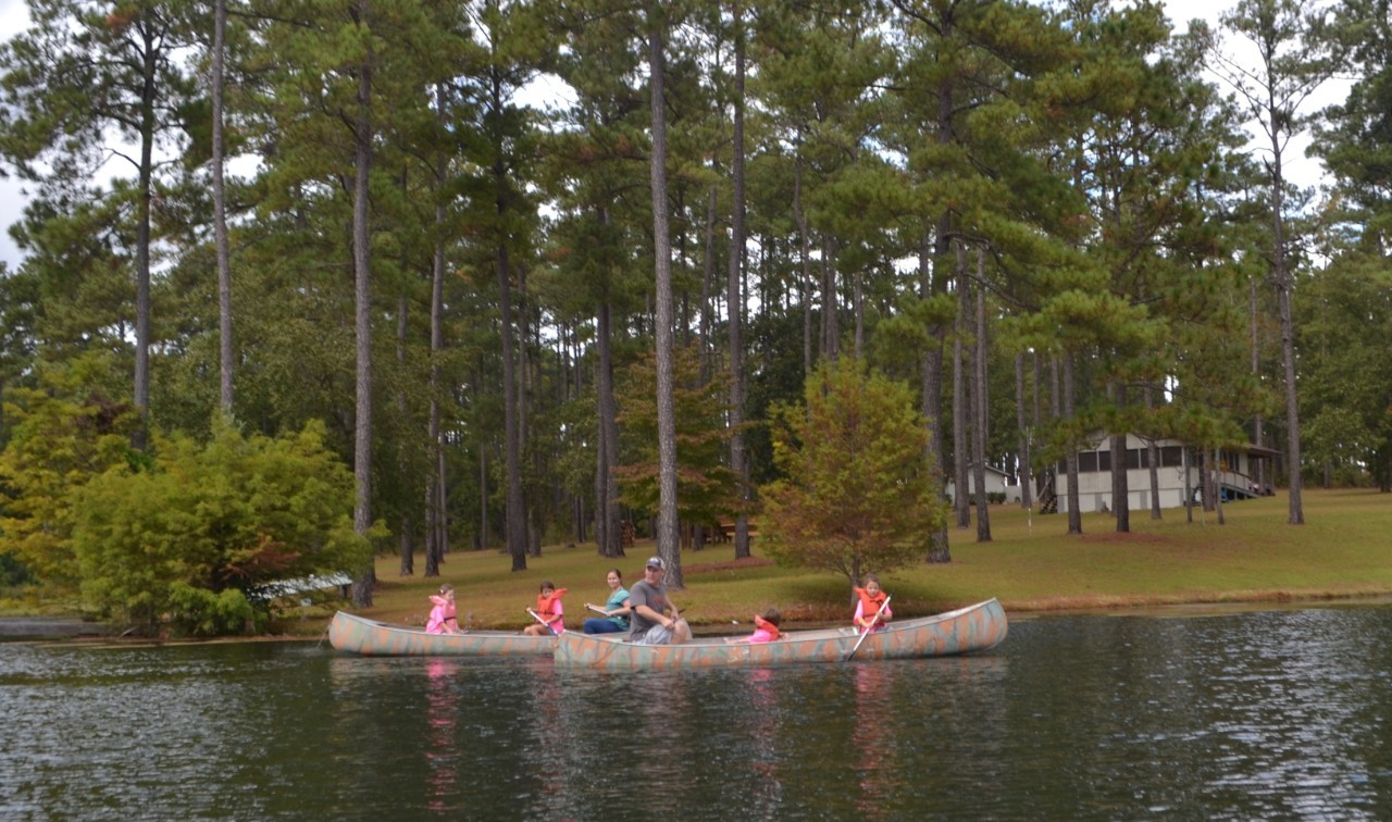 The girls of Daisy Troop #4890 enjoy a scenic canoe ride with Troop Leader Karl.