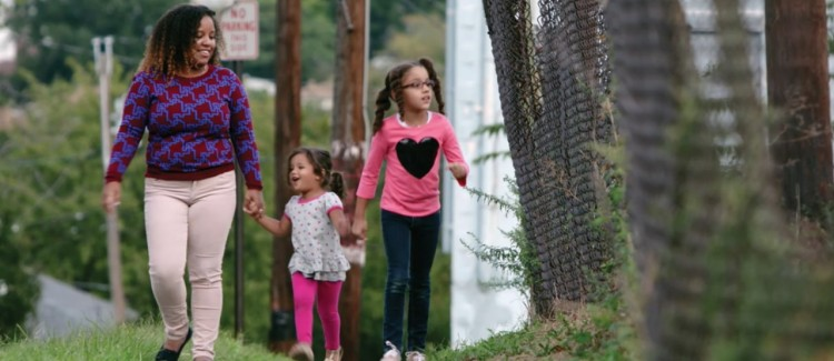 Elaine, Penelope and Olivia take a walk in their community.