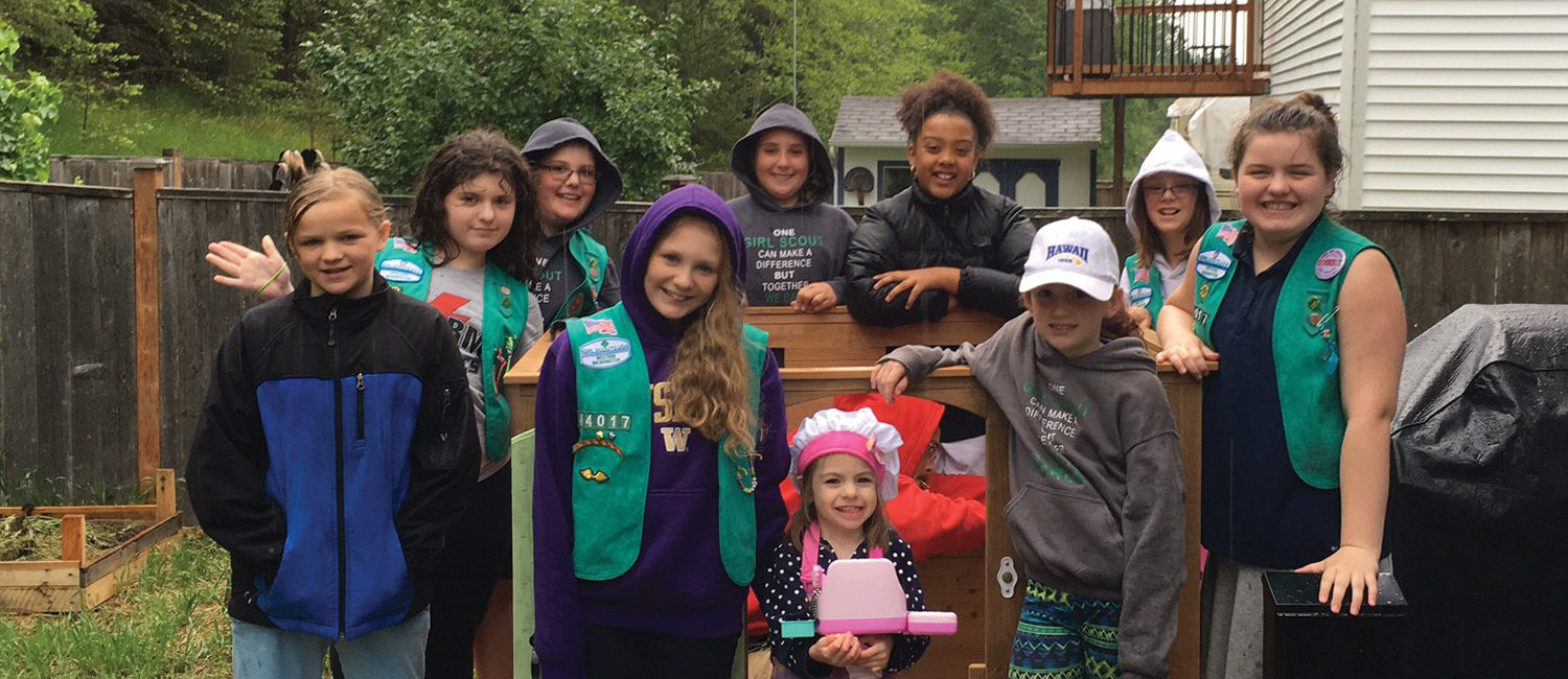 Girl Scout Troop 44017 and Hannah Mae show off their playhouse-in-the-making.