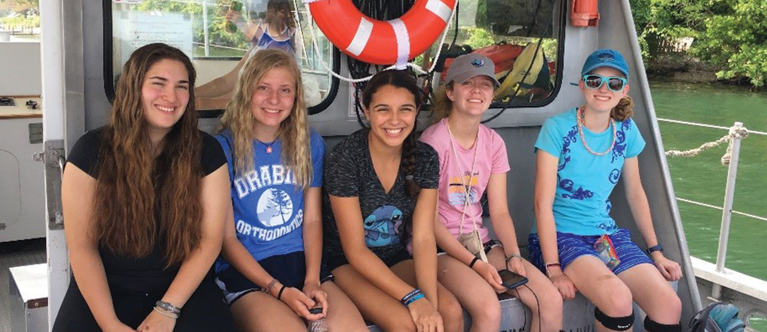 Girl Scouts Carmen, Theresa, Adriana, Erin and Charlotte island hop on Lake Erie—in-between catching fish for scientists to study and leading a beach clean-up—all in one day!