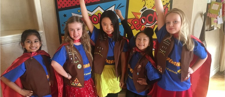 The Supergirls, a team of young Girl Scout robotics rock stars, stand proud and tall.
