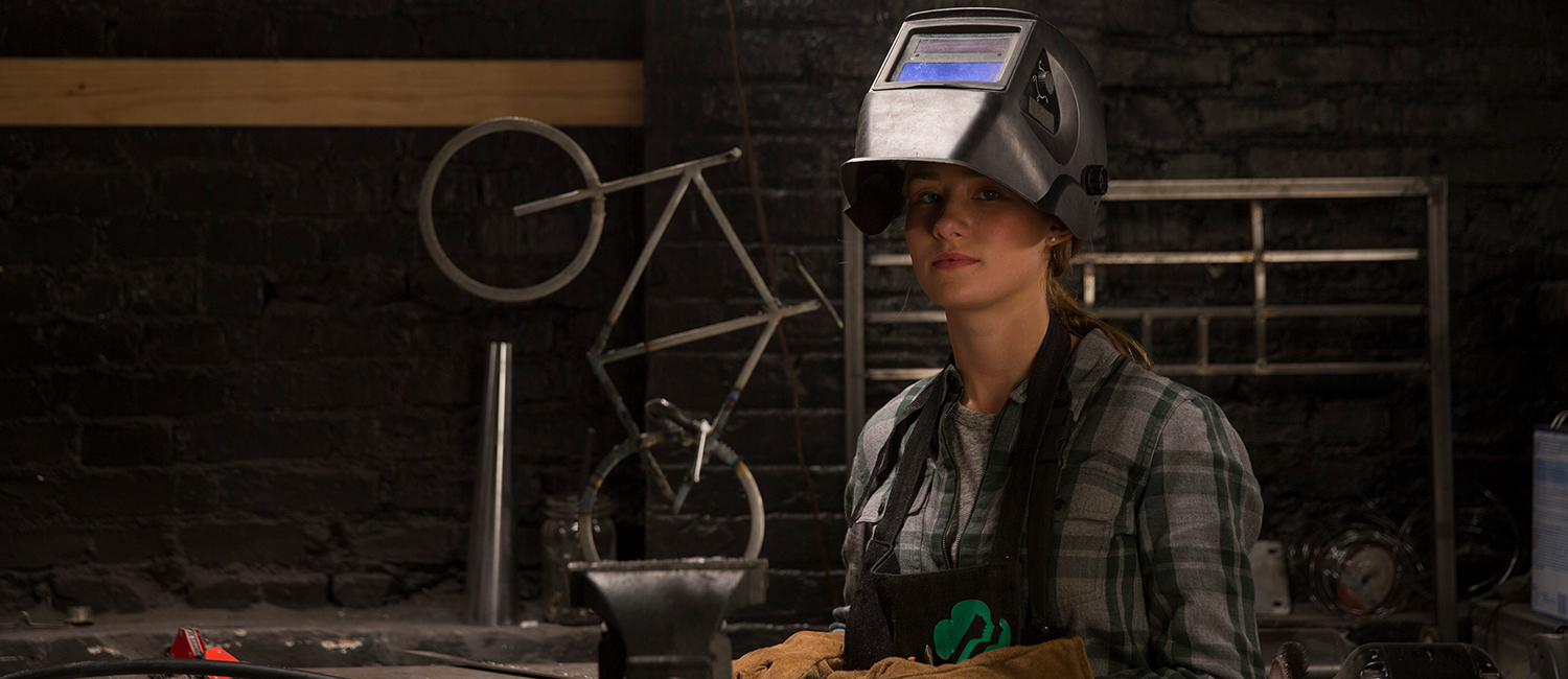 Kylie welds on set of