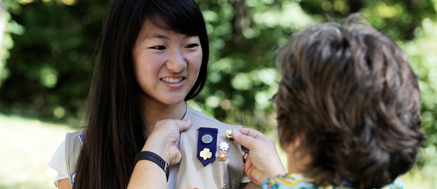 A Girl Scout receives her Gold Award.