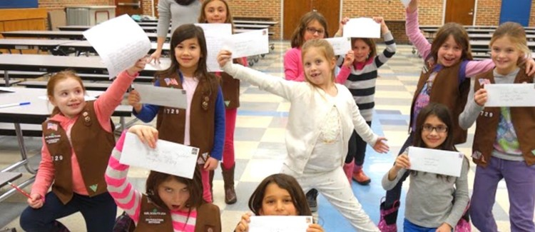 Girl Scout Brownies Show Off Their Advocacy Letters to Michigan Governor Rick Snyder
