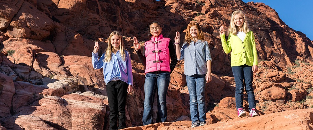 A group of Girl Scouts embrace tradition