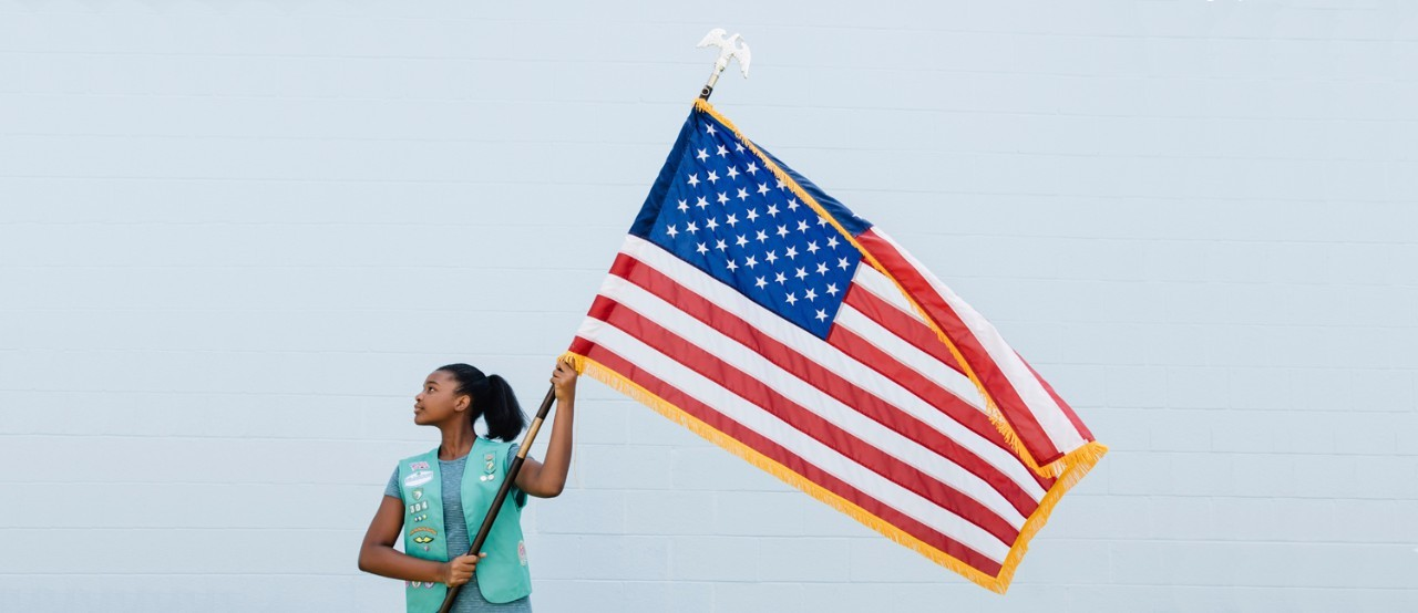 Girl Scout with United States Flag