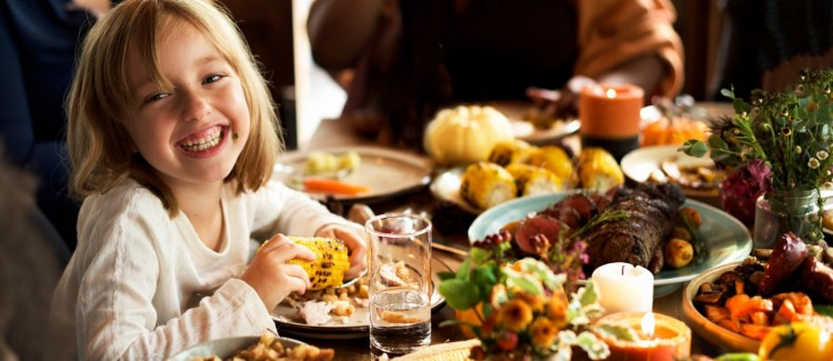 Girl enjoying family thanksgiving with her parents