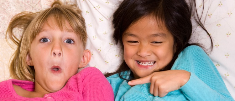 Two young girls at their first sleepover slumber party