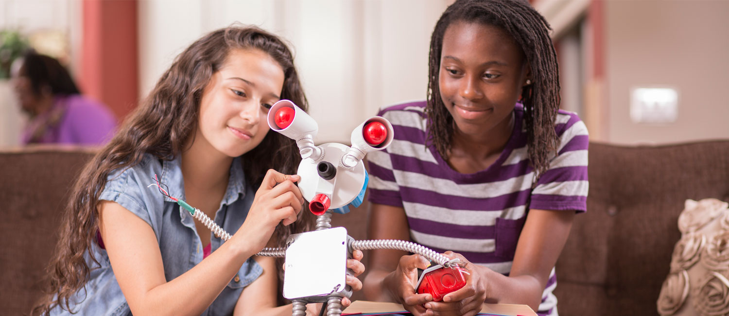 girls making a robot