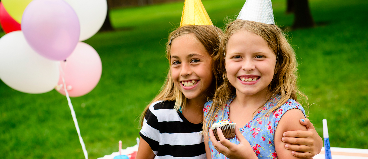 two girls having fun at a child's birthday party