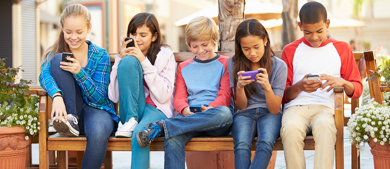 teenagers texting on their cell phones