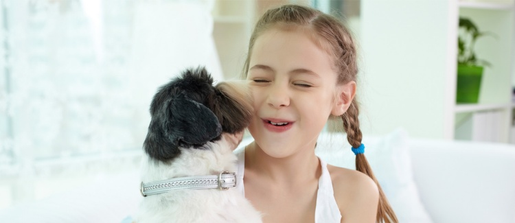 Young girl with cute dog, her first pet.