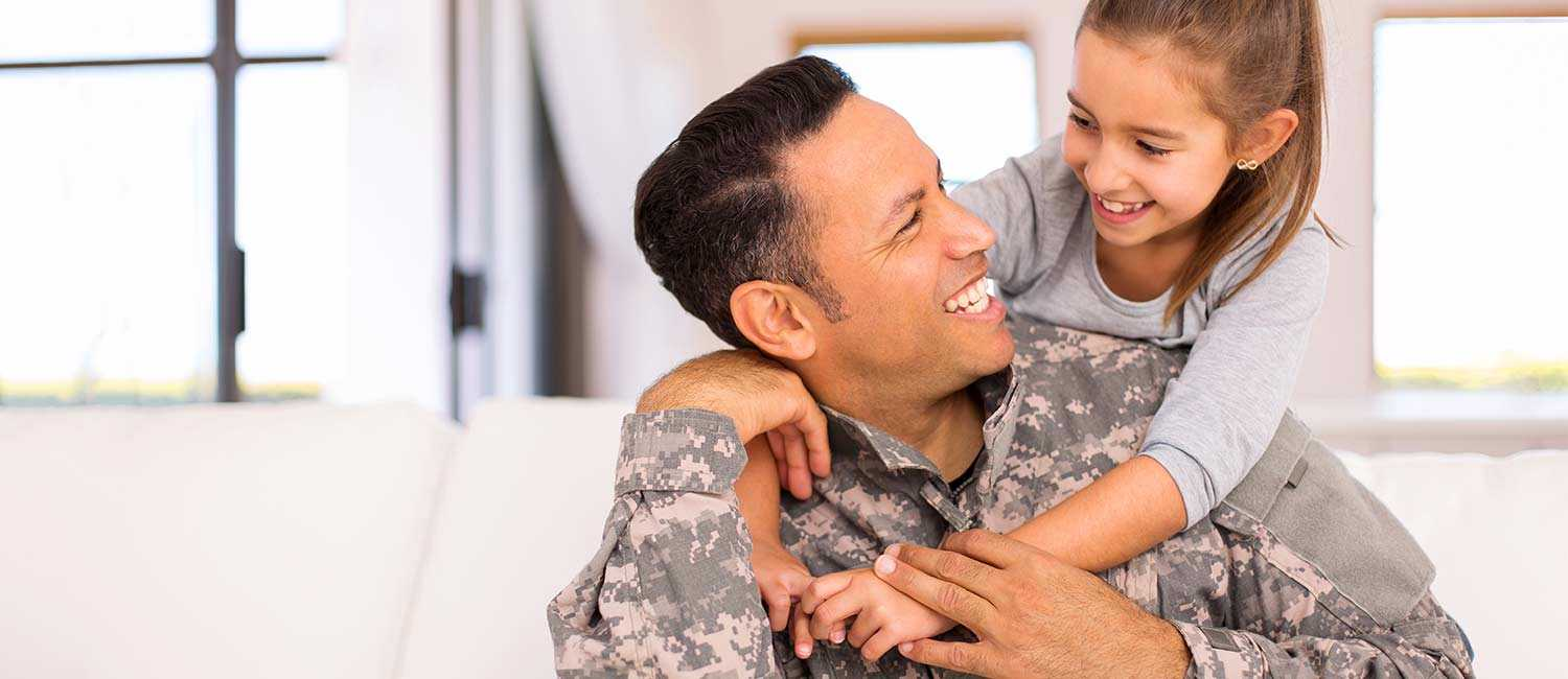 military dad hugging daughter