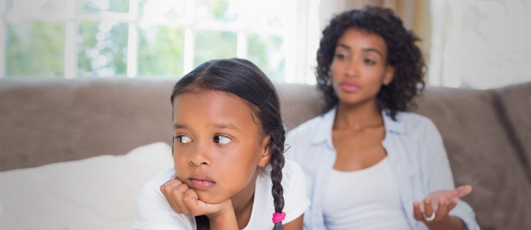 girl looking upset after stressed mom yelled at her during the coronavirus pandemic