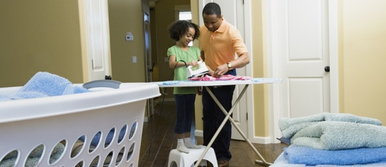 young kid doing chores with father against gender sterotypes