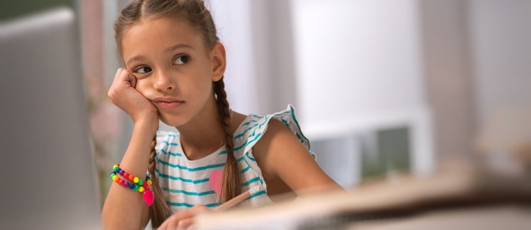 girl looking bored feeling jealous over other kids' in-person playdates during the pandemic