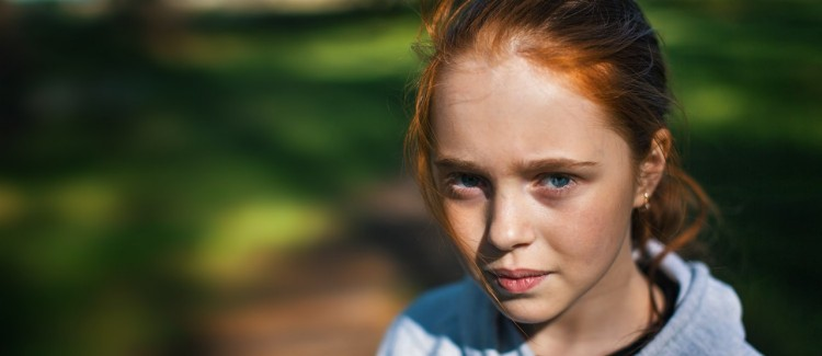 red haired girl unsure if she should apologize and say sorry