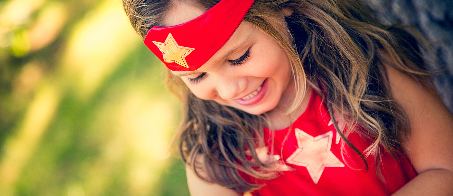Little girl daughter dressed up as a superhero like Wonder Woman