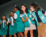 Photo of Junior Girl Scouts clapping and singing. © GSUSA. All rights reserved.