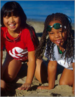 Photo of two younger Girl Scouts on the beach. © GSUSA. All rights reserved. (Photographer: Lori Adamski-Peek)