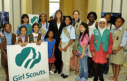 Photo of Juliette Gordon Low posing with some of the nation's first Girl Scouts. © GSUSA. All rights reserved.