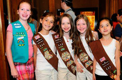 Girl Scouts pose at a special screening of Kit Kittredge: An American Girl starring Abigail Breslin, on Thursday June 19 in Times Square, New York.