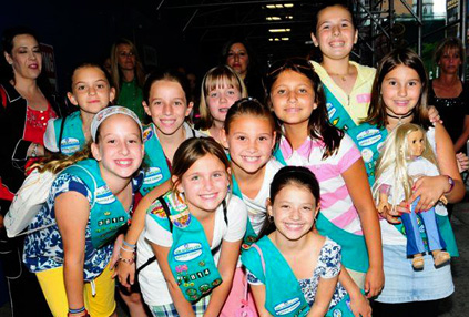 Local Girl Scouts pose outside of the Ziegfeld Theater in New York for the Premier of Kit Kittredge: An American Girl starring Abigail Breslin on Thursday June 19.