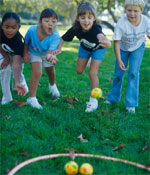 Photo of Girl Scouts tossing balls. © GSUSA. All rights reserved. (Photographer: Lori Adamski-Peek)