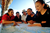 Photo of girls reading a map
