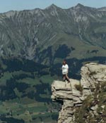 Photo of a girl standing on a cliff. (Photo courtesy of WAGGGS)