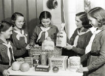 Photo of Girl Scouts gathering food for neighbors in need. © GSUSA. All rights reserved.