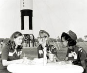 Photo of Girl Scouts sitting in front of the Apollo 12 moon launch. © GSUSA. All rights reserved.