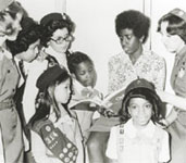 Photo of Girl Scout president Gloria Scott with Girl Scouts. © GSUSA. All rights reserved.