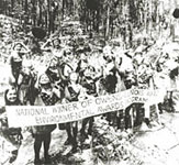 Photo of Girl Scouts holding national environmental award banner. © GSUSA. All rights reserved.