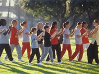 Photo of Girl Scouts practicing tai chi. © GSUSA. All rights reserved. (Photographer: Lori Adamski-Peek)