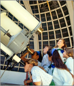 Photo of girls looking through a telescope.