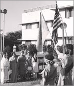 Photo Girl Scouts holding flags in Pakistan, 1961. © GSUSA. All rights reserved.